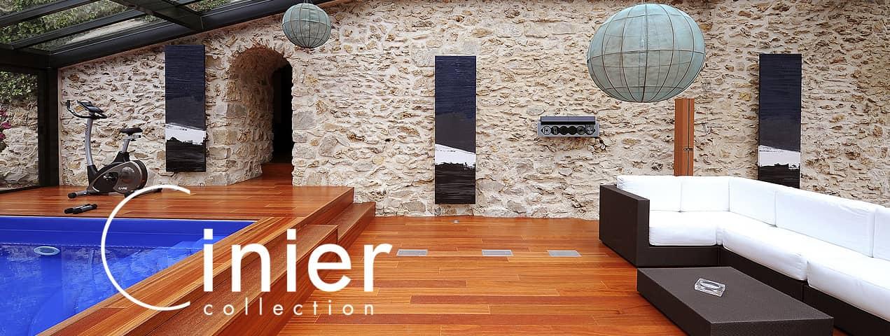 una amplia sala con calentada con un radiador de diseñador marca cinier